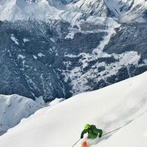 Skier riding powder snow at Verbeir