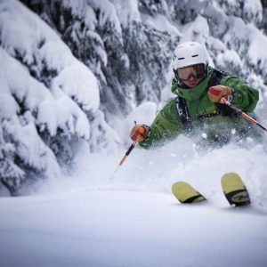 Skier riding powder snow