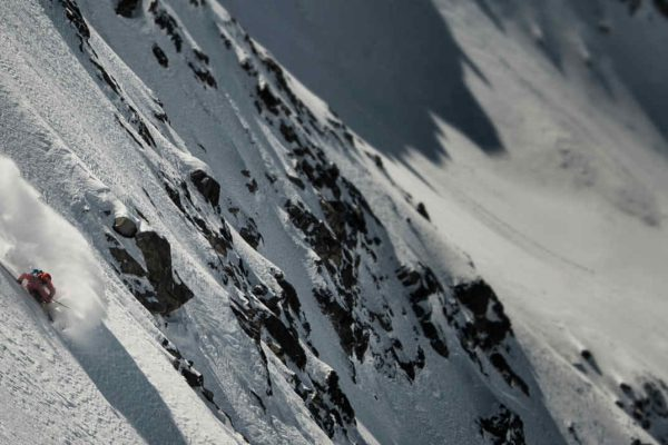 Freeride skiing in a Verbier's steep face