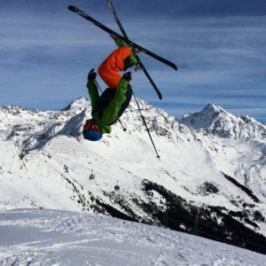 Skier doing a backflip on savolyers area in Verbier