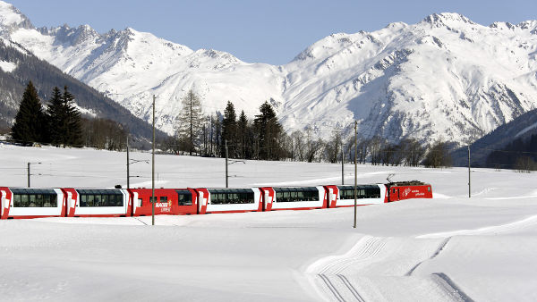Swiss train on a snowed landscape