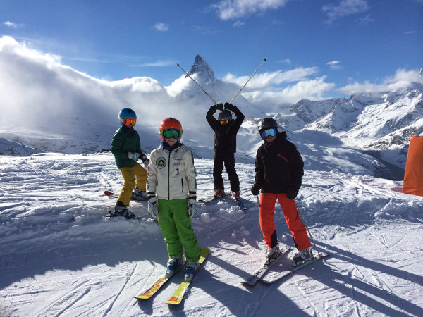 Ski pupils of a ski lesson in Zermatt