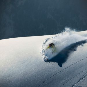 Skier on powder on a clean snowpack