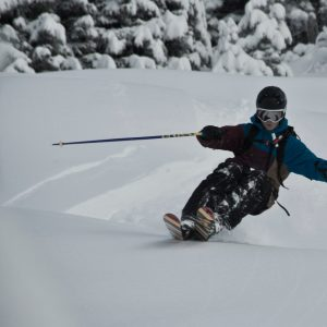 Skier lifting the tips on powder snow