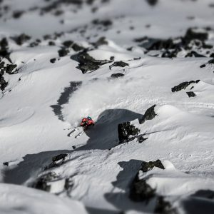Skier finding his way down between rocks in Verbier