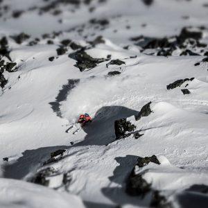 Skier finding his way down between rocks in Verbier
