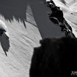 Freeride skier on powder in Verbier