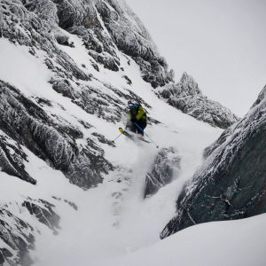 Skier jumping over rocks in a shut in Verbier