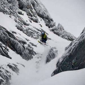 Skier jumping over rocks in a shut in Verbier