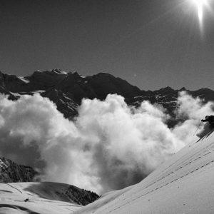 Skier skiing powder in Verbier