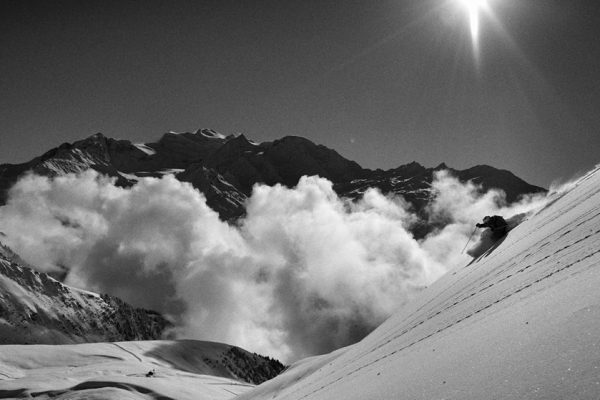 Skier skiing powder in Verbier